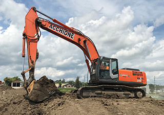 acchione equipment, orange excavator